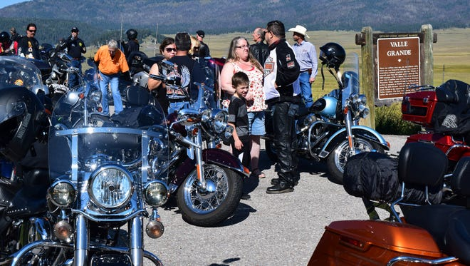 Motorcyclists take a break at the Valles Caldera National Preserve during this year's annual Ride For the 4-H Clover Motorcycle Rally hosted by New Mexico State University's Cooperative Extension Service. Participation has increased during the first three years from 60 to 90 riders.