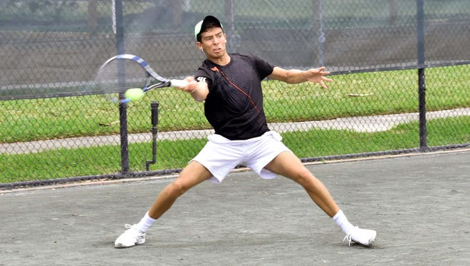 Richie Torres returns the ball during the Mardy Fish tennis tournament on Monday.