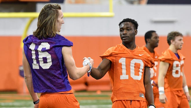 Clemson quarterback Trevor Lawrence (16) and wide receiver Derion Kendrick (10) during the Tigers opening day of spring practice on Wednesday, February 28, 2018.