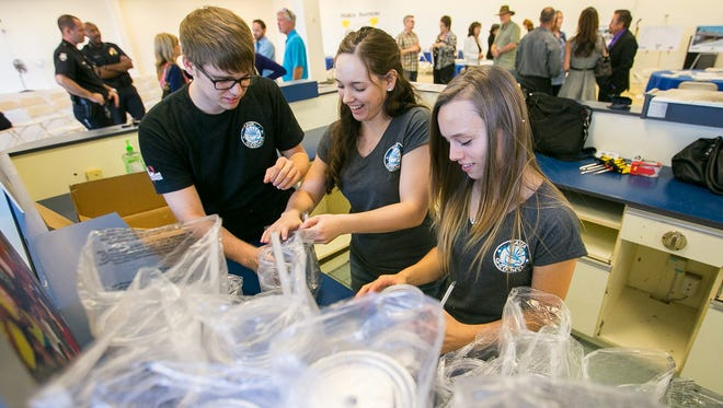 From left, Java Grounds employees Cody Thwaits, Rachael Weide and Jacquelyn Ortega work at the new Java Grounds location in downtown Peoria.