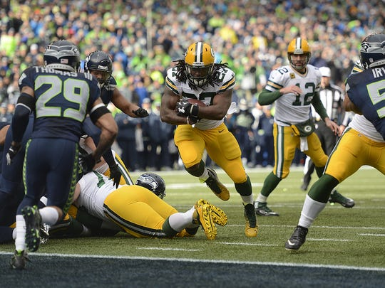 Green Bay Packers running back Eddie Lacy (27) runs towards the end zone in the first quarter during Sunday's NFC Championship game against the Seattle Seahawks at CenturyLink Field in Seattle, Wash.