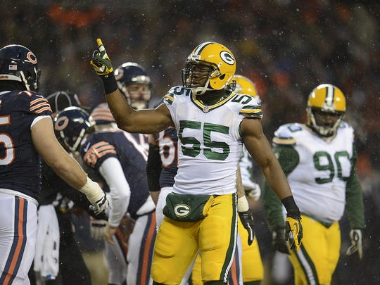 Packers linebacker Andy Mulumba reacts after getting his first career sack in a 2013 game against the Chicago Bears.