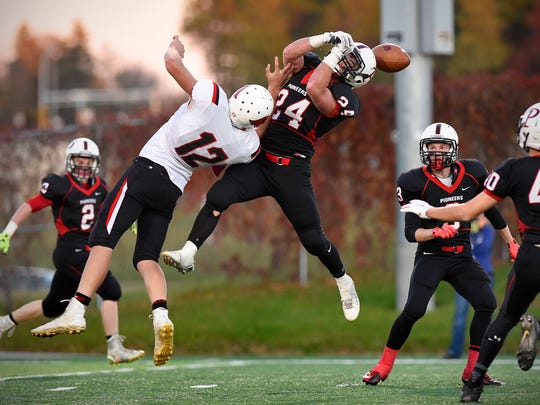 Pierz's Noah Boser 24 ties unsuccessfully to pick off a pass to   Annandale's Cory Schmidt in the second half Saturday, Oct. 4 at Husky Stadium.