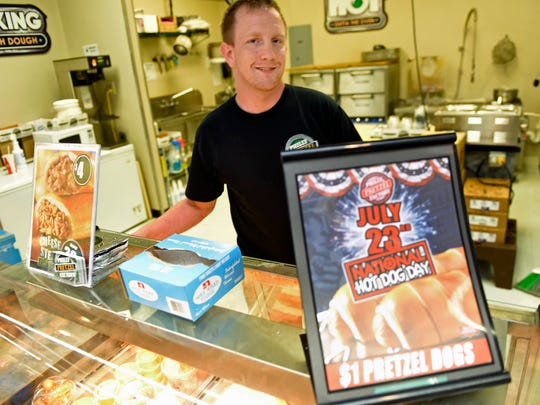 Derek Maple, manager at Philly Pretzel Factory, Shippensburg, is gearing up for National Hot Dog Day on Saturday, July 22, 2016.