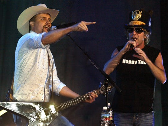 John Rich, left, and Big Kenny, right, of Big & Rich perform at the Iowa State Fair grandstand show Tuesday. (Holly McQueen/The Register)
