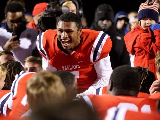 Oakland's JaCoby Stevens (7) celebrates with the team