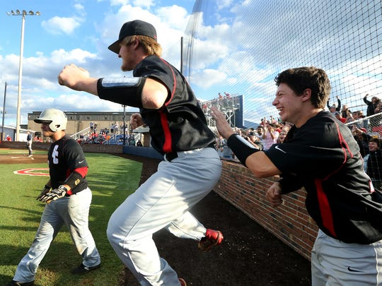 Stewarts Creek realizes that they will be plaing in the State Championship game as player's (L to R) Austin Steel (22), Tayne Davis (17) and Chase Vondohlen (18) react to a homerun hit to win the in game 14 against Jefferson County during the Class AAA Baseball Tournament during Spring Fling on Thursday, May 25, 2017.