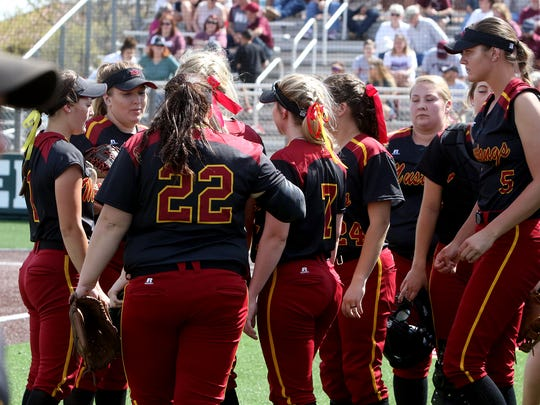 The Midwestern State Mustangs huddle up between innings against West Texas A&M Saturday, March 24, 2018, at Mustangs Park at MSU.