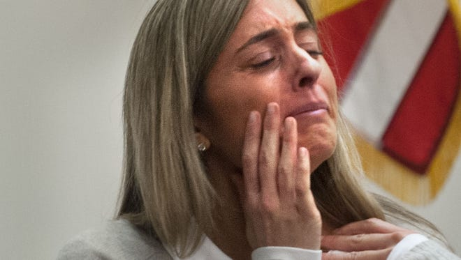 In this photo taken on Monday, Nov. 24, 2014, Abigail Simon cries while testifying in her trial in Grand Rapids, Mich. Simon is accused of having sex with a 15-year-old boy whom she tutored while employed at Catholic Central High School in 2013.  (AP Photo/The Grand Rapids Press, Chris Clark) ALL LOCAL TELEVISION OUT; LOCAL TELEVISION INTERNET OUT