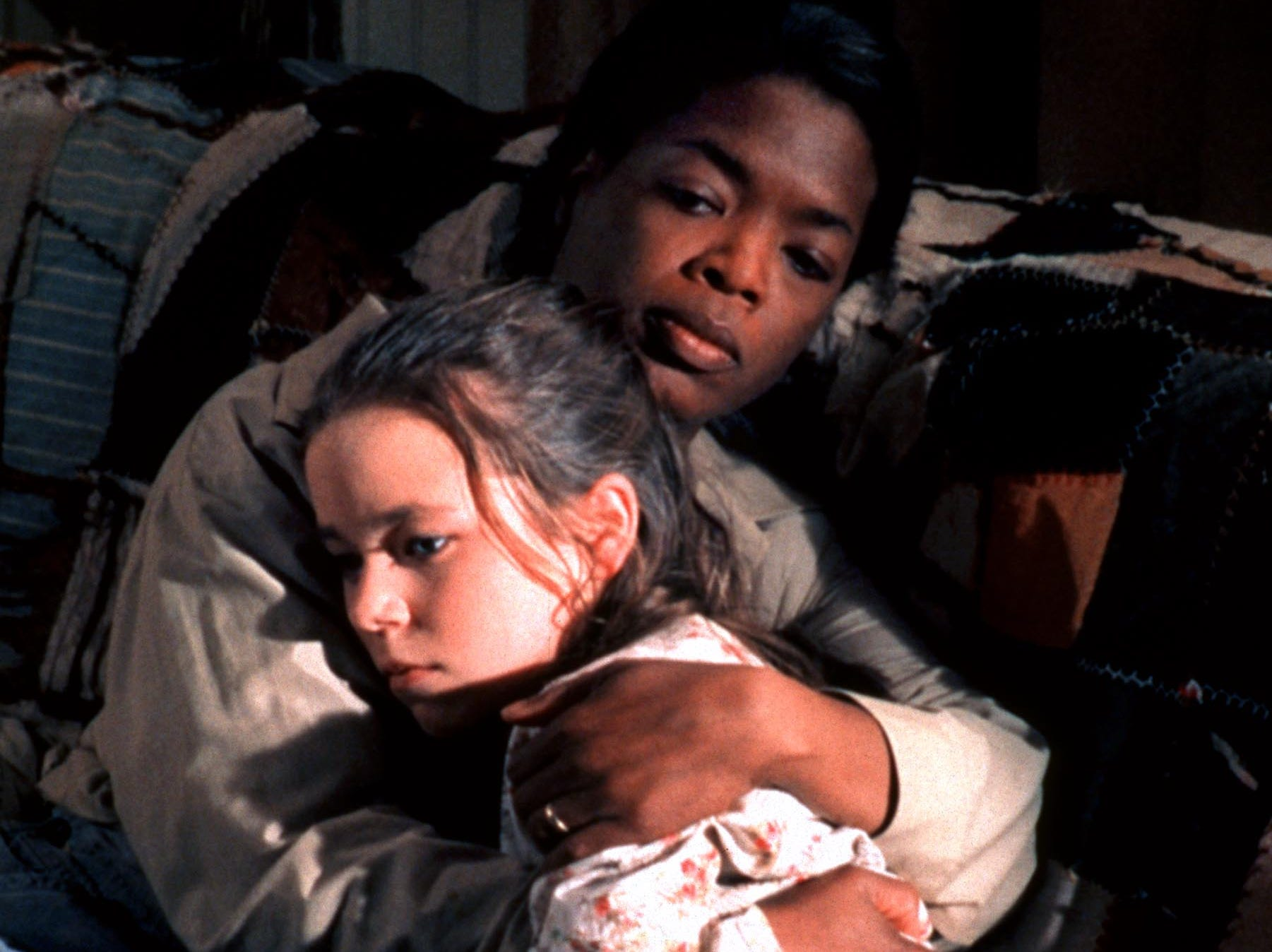 'Before Women Had Wings' | In 1997, Oprah took yet another go at a TV movie with 'Wings.' She produced the film and played Zora, a kind woman who helps save two daughters from an abusive mother, played by Ellen Barkin (who received an Emmy award for her portrayal of the violent Glory Marie). In this scene, Zora (Winfrey) comforts Avocet (played by Tina Majorino).