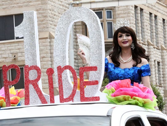 Barbie Reyes rides atop the last float in the Parade