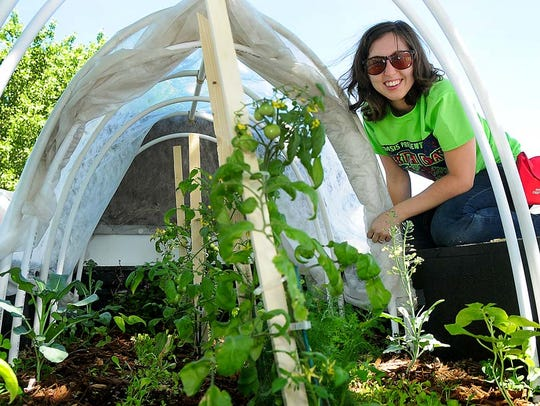 Lea Wise-Surguy works on a mobile garden at a recent