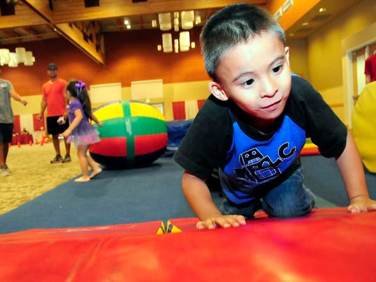 Able Luna of Las Cruces plays on the Gym Magic obstacle