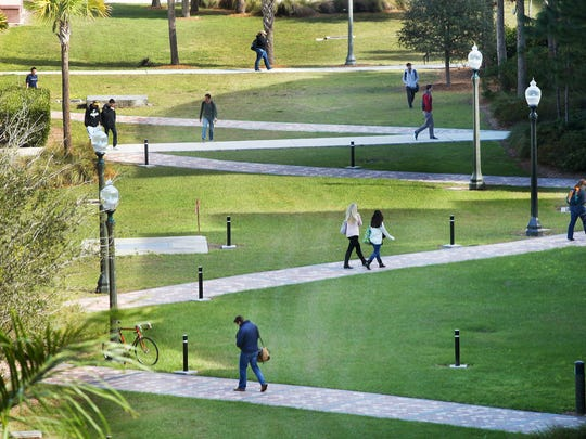 Students at FGCU travel through the courtyard while attending classes.