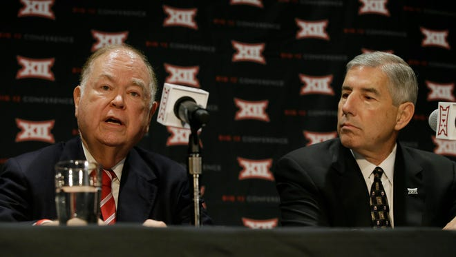 Oklahoma President David Boren, left, speaks as Big 12 Commissioner Bob Bowlsby looks on during a news conference after The Big 12 Conference meeting in Grapevine, Texas, Monday, Oct. 17, 2016. The Big 12 Conference has decided against expansion from its current 10 schools after three months of analyzing, vetting and interviewing possible new members.