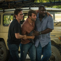 Billy Burke, left, James Wolk and Nonso Anozie star in CBS' 'Zoo.'