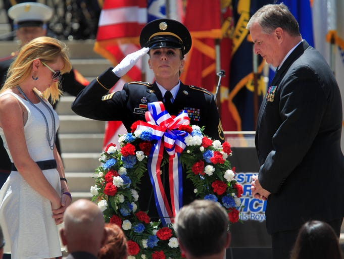 Indianapolis Mayor Greg Ballard, right, spoke at and helped lay a wreath at the Annual 500 Festival Memorial Service on Monument Circle on Friday, May 23, 2014.