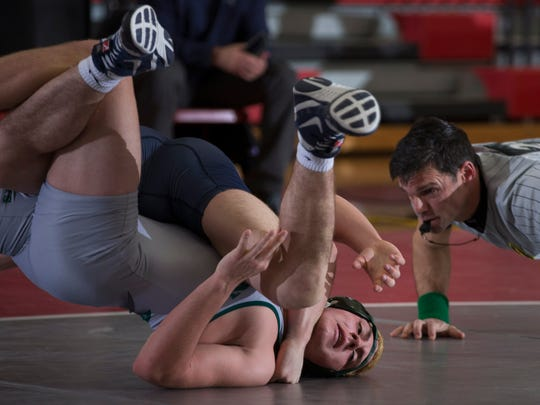 Raritan's Justin Acevedo tries to stay off his back