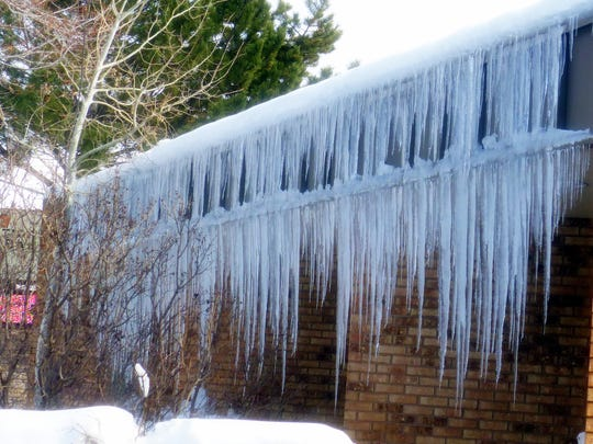 A double dip of icicles trims First National Bank in Ruidoso.