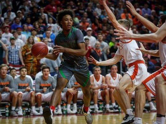 Des Moines North sophomore Tyreke Locure moves the ball inside against Valley during the Iowa High School state basketball tournament at Wells Fargo Arena in Des Moines on Wednesday, March 8, 2017.