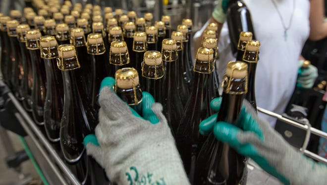 Bottles of Brooklyn Local 2, a Belgian-inspired Dark Abbey Ale, are loaded on to a conveyor for labeling, at the Brooklyn Brewery in Brooklyn, N.Y. in this 2013 file photo.