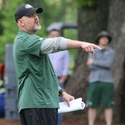 Offensive coordinator John Morton watches his offense