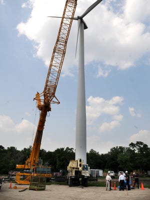 A crane is put into place Wednesday to repair the wind turbine at the St. Cloud VA Health Care System in July 2013.