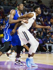 Hillcrest Prep's DeAndre Ayton, left, defends Westtown's Mohamed Bamba during play Sunday at the Culligan City of Palms Calssic at the Suncoast Credit Union Arena in Fort Myers.