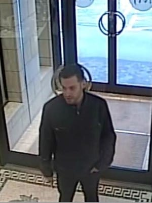A surveillance photo of the man accused of stealing two Rolex watches from Mann's Jewelers in Brighton.