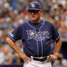 Tampa Bay Rays manager Joe Maddon (70) looks on during the eighth inning against the Detroit Tigers at Tropicana Field. Tampa Bay Rays defeated the Detroit Tigers 1-0. Mandatory Credit: Kim Klement-USA TODAY Sports