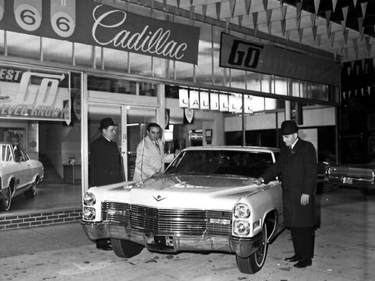 A new Cadillac is polished while on display at a Vineland dealership in late 1965.