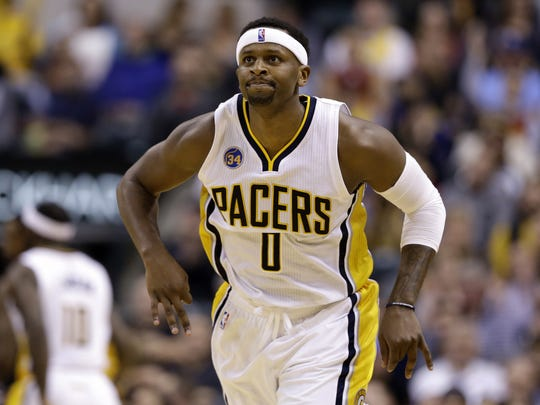 Indiana Pacers forward C.J. Miles (0) signals after making a three-pointer against the Orlando Magic at Bankers Life Fieldhouse on March 31, 2016.