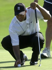 Tiger Woods looks at his approach shot during the Battle at Bighorn Monday, July 29, 2002.