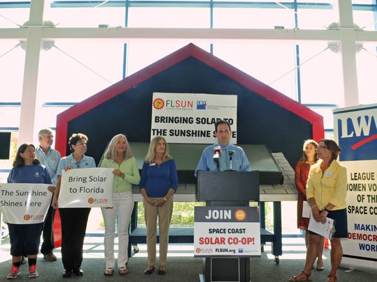 Dan Bennett of the Brevard Federation of Teachers speaking at the podium.Florida Solar United Neighborhoods (FLSUN), partnering with League of Women Voters for the Space Coast Solar Co-op Press Conference held Monday, Oct. 24, at the University of Central Florida Florida Solar Energy Center in Cocoa. Their goal is assistance in achieving widespread adoption of solar energy in Brevard County.