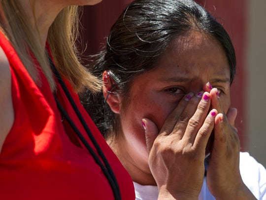 In this file photo, Rita Hernandez, the mother of missing 9-year-old Diana Alvarez, wipes away tears during a press conference in June in Fort Myers. Alvarez went missing in late May.