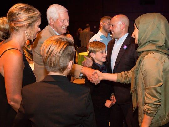 Bob Fisher and Kasar Abdulla, both honorees, shake hands at Siloam Health's inaugural Amplify Nashville awards.