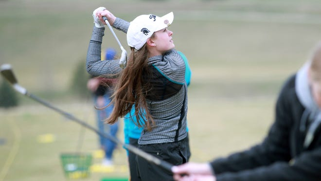 West High's Avery Kout practices with teammates at the Brown Deer Golf Club in Coralville on Monday, April 6, 2015.   David Scrivner / Iowa City Press-Citizen