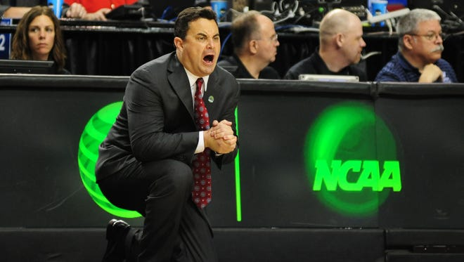 Arizona Wildcats head coach Sean Miller instructs against the Ohio State Buckeyes during the NCAA Tournament last season.