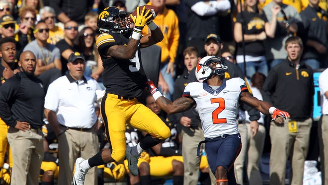 Jerminic Smith pulls in a 49-yard pass during Iowa's 29-20 win over Illinois on Oct. 10. He had four catches for 118 yards in that game, all in the first half.