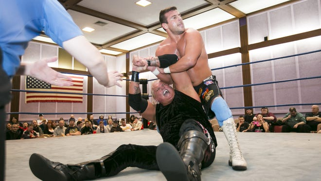 Matt Striker holds onto Gangrel at a past West Coast Wrestling Connection event. The group will be at this year's Northwest Comic Fest.