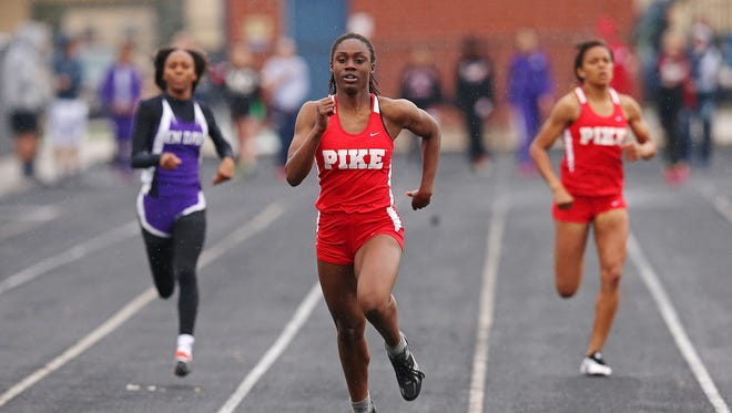 From left, Ben Davis' RaVon Woodson, Pike's Lynna Irby, and Pike's Jailyn Ross approach the finish line of the 200 meter dash at the IHSAA girls track and field sectional at Decatur Central, May 17, 2016.