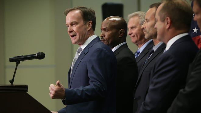Attorney General Bill Schuette announces civil charges in the Flint water crisis on Wednesday June 22, 2016, at the Harding Mott Building on the University of Michigan-Flint campus.