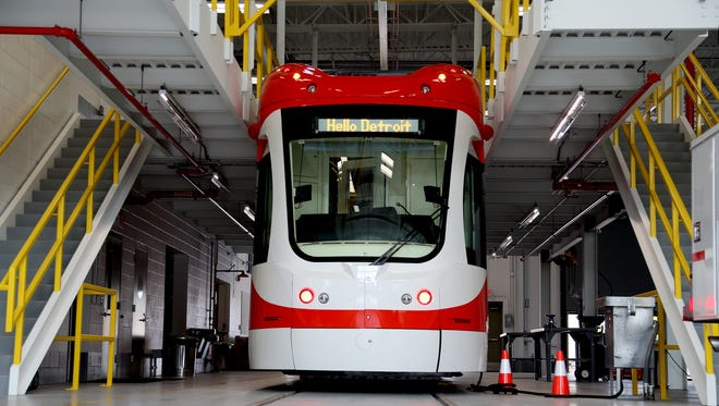 The QLine trolley, one of six that will be in operation in the summer of 2017, sits in a bay inside the Penske Tech Center on Woodward Avenue in Detroit on Wednesday, September 21, 2016.