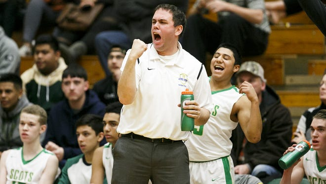 McKay's head coach Dean Sanderson celebrates a basket in the second quarter of a game against McMinnville on Tuesday, Jan. 3, 2017, at McKay High School. The Royal Scots secured an 80-79 victory,