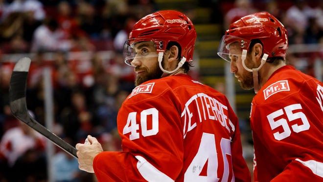 Feb 15, 2017; Detroit, MI, USA; Red Wings left wing Henrik Zetterberg and defenseman Niklas Kronwall display a patch on their sweaters for owner Mike Ilitch in the third period against the Blues at Joe Louis Arena. Ilitch passed away Feb. 10, 2017.