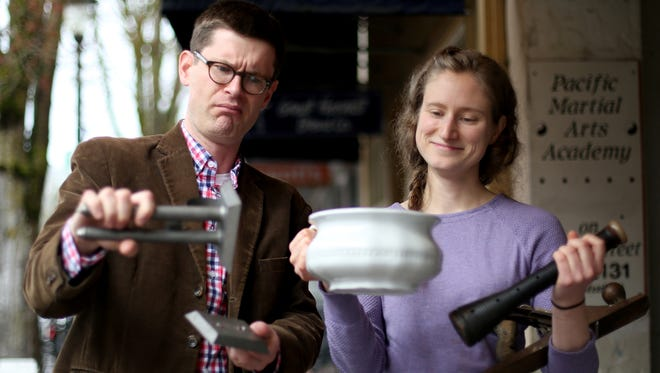 """Bob Reinhardt, the executive director of the Willamette Heritage Center, and Kylie Pine, a museum curator, look over items that will be on display during an after-hours event called """"What Is It?"""" on March 27."""