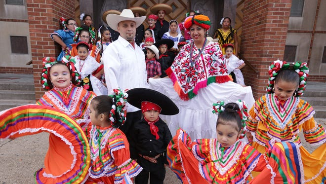 El Ballet Folklorico Moyocoyani Izel president Maria Luisa Carrillo and lead dance instructor Jaime Carrillo pose for a photo outside of St. Gabriel Parish in Detroit on Friday, November 6, 2015 with members of the dance company. The dance company received a grant from the Knight Foundation as part of it's investing an additional $9 million into Detroit's cultural scene to renew the Knight Arts Challenge program for an additional three years.