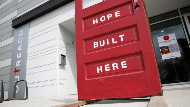 "A door with the saying ""Hope Built Here"" sits outside the new at the Outreach Inc.'s new facility, Monday, April 17, 2017, at 2416 E. New York St.  The nonprofit serves homeless youth in the city."