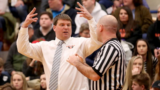 Sprague head coach BJ Dobrkovsky talks with a referee in the first half of the Sprague vs. South Salem boy's basketball game at South Salem High School on Friday, Feb. 3, 2017. Sprague won the game 64-58.