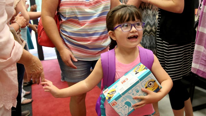 Micah Garcia high-fives teachers on her first day of first grade during a red carpet welcome for back-to-school at Gubser Elementary School in Keizer on Wednesday, Sept. 6, 2017. Wednesday was the first day of school for most grades in Salem-Keizer.